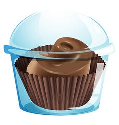 A chocolate cupcake inside a disposable container vector