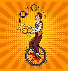 Circus juggler on unicycle pop art vector