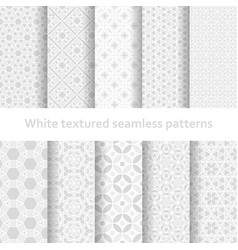 White textured seamless patterns set vector