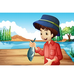 A fisherman holding a fish vector