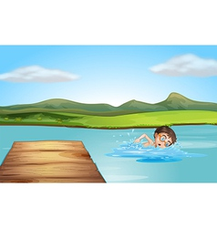 A boy swimming near the diving board vector