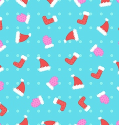 Christmas hat and mitten pattern vector