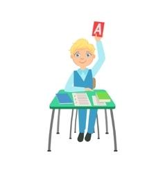 Schoolboy sitting behind the desk in school class vector