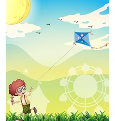 A boy playing with his kite vector image