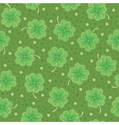 Seamless background with shamrock vector image