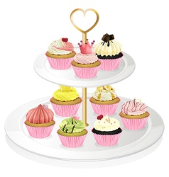 A cupcake tray with pink cupcakes vector