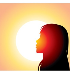 Sillouette of woman in front of sun vector image