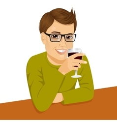 Handsome man with glasses drinking wine vector