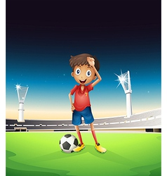 A field with a soccer player in a red uniform vector