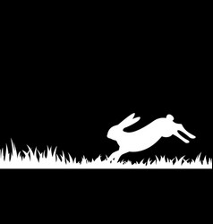 Silhouette of a hare in the grass vector