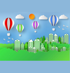 Paper art style of landscape with balloon in city vector