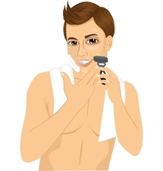 young man shaving with razor vector image