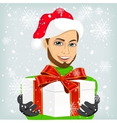 Young man wearing a santa hat offering a gift vector