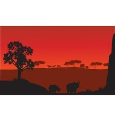 Silhouettes of african with rhino animals vector