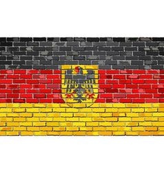 German flag with emblem on a brick wall vector