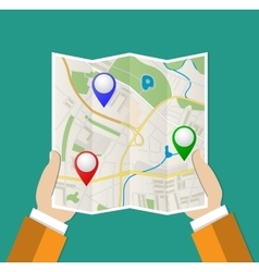 Folded paper map in hand vector