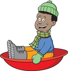 Cartoon boy on a snow sled vector image