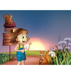 A girl with a shovel standing near the wooden vector image vector image