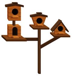 Wooden bird houses on one pole vector