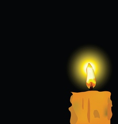 Burned candle on black background vector
