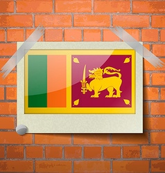 Flags Sri Lanka scotch taped to a red brick wall vector image