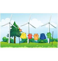 A hilltop with hanging clothes and windmills vector