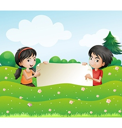 A boy and a girl holding an empty cardboard vector