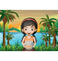 A girl holding an aquarium vector image