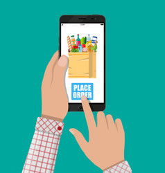 hand and smartphone with shopping bag vector image vector image