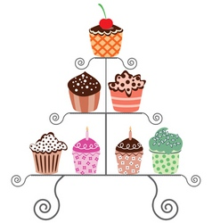 set of various cupcakes on a stand vector