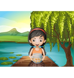 A girl with an aquarium standing at the riverbank vector