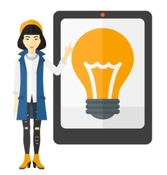 Woman pointing at tablet computer with light bulb vector