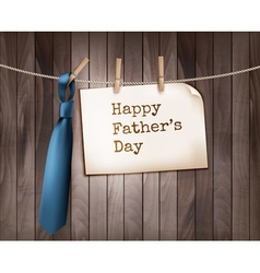 Happy fathers day background with a blue tie on a vector