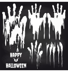 White handprints on chalkboard for halloween vector