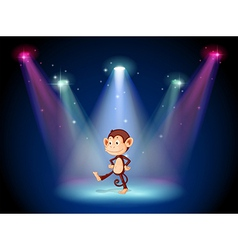 A monkey dancing on the stage with spotlights vector image
