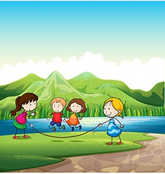 Four kids playing with a rope near the river vector