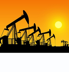 Silhouette of working oil pumps on sunset backgrou vector