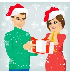Man and woman with christmas present vector