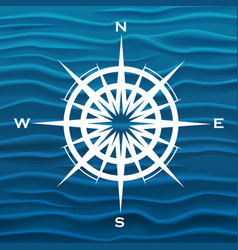 Wind rose over blue waves background vector
