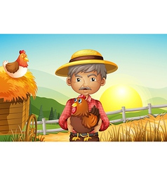 An old man at the farm holding a rooster vector image vector image