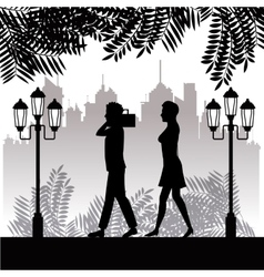Silhouette man radio and woman walking park twon vector