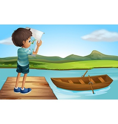 A boy at the river with a wooden boat vector image