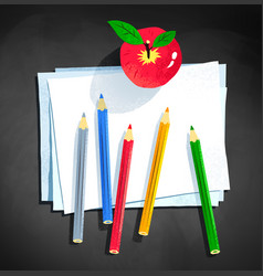 color pencils and apple laying on paper vector image vector image