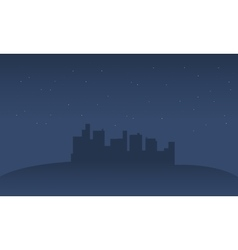 Silhouette of city in hills vector