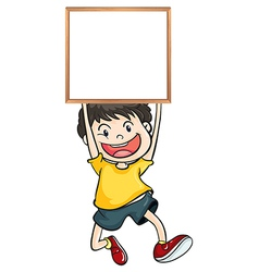 A boy holding an empty framed banner vector image