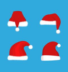 red santa claus hats set christmas vector image vector image