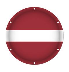 Round metallic flag of latvia with screw holes vector