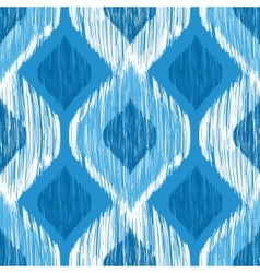 Ikat ethnic seamless pattern in blue and white vector