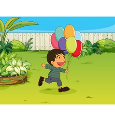 A smiling boy with balloons vector image vector image