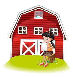 A girl reading in front of the barnhouse vector image